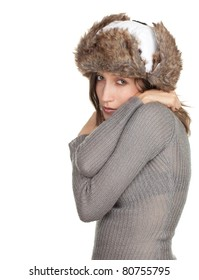 young woman in white winter hat and grey warm sweater