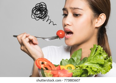 Young woman who hates vegetables.