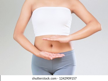 young woman who makes  protective shape by hands on her stomach. health care