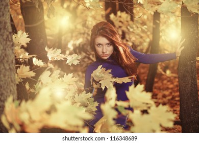 young woman at windy fall forest