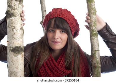 young woman in winter clothes between birch trees. On white background