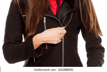 Young woman in winter clothess unzipping her coat