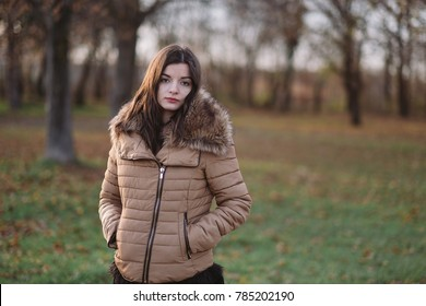 Young woman in winter coat