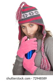young woman in winter hat  and mittens with big blue cup