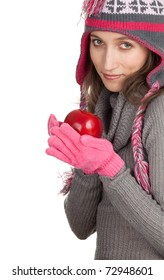 young woman in winter hat  and mittens with red apple