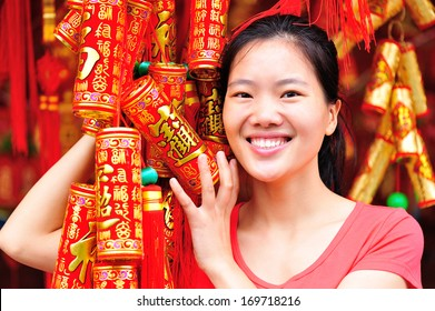 young woman wishing a happy chinese new year