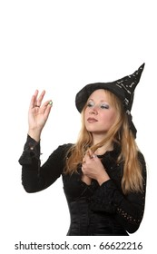 A young woman in a witch costume