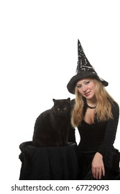 A young woman in a witch costume with a black cat