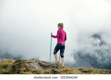 Young woman without backpack hiking in the mountains. Alps. Austria