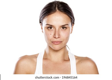 young woman without make-up with blank expression