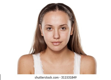 young woman without make-up, looking at the camera