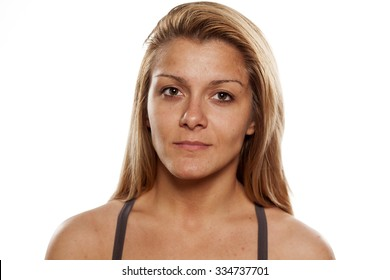 young woman without makeup on a white background