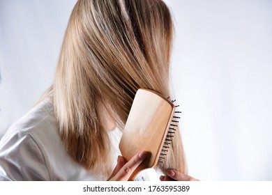 young-woman-wooden-comb-brushing-260nw-1