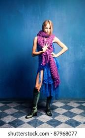 young woman in wool scarfs, studio shot, full body shot