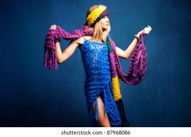 young woman in wool scarfs, studio shot