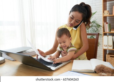 Young woman working with baby on her knees