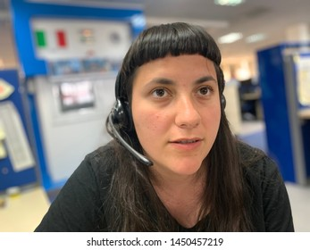 Young woman working at call center