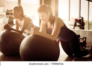Young woman working exercise on Pilates ball.