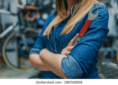 Young woman working in factory. Proud Female Mechanic. Girls can fix things too