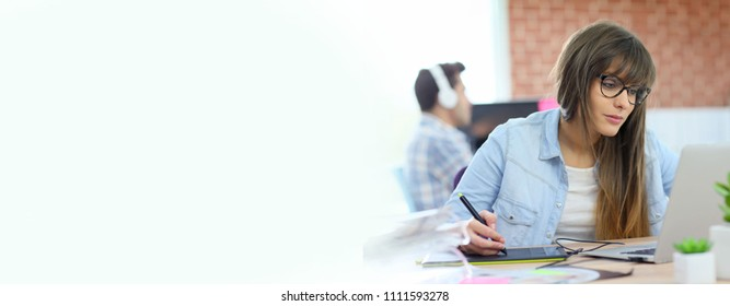 Young woman working with graphic tablet in office, template
