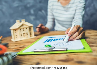 Young woman working hard work at home house tax calculating.