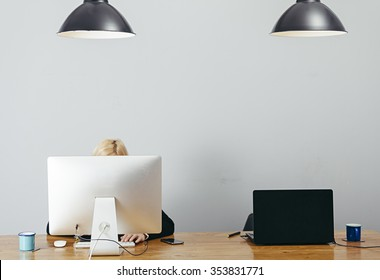 young woman working in a homely office with graphic tablet