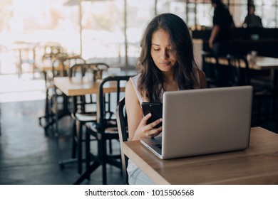 Young woman working laptop in coffee shop