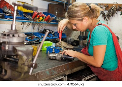 young woman working in a mechanic shop