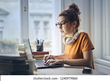 Young woman working on a laptop.