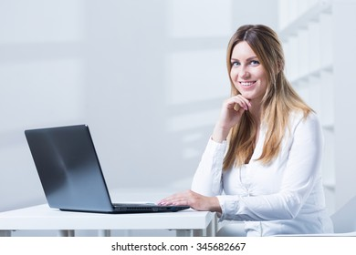 Young woman is working on the laptop