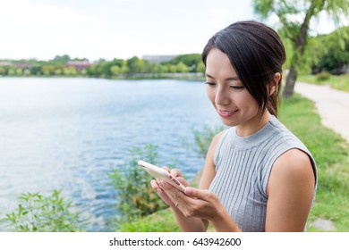 Young woman working on mobile phone