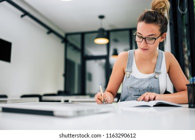Young woman working on a project.
