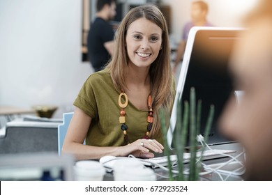 Young woman working in open space office