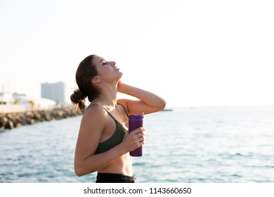 Young woman working out at the beach in the summer
