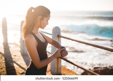 Young woman working out on beach