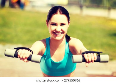 Young woman working out outdoors