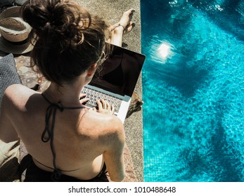 young woman working at the pool