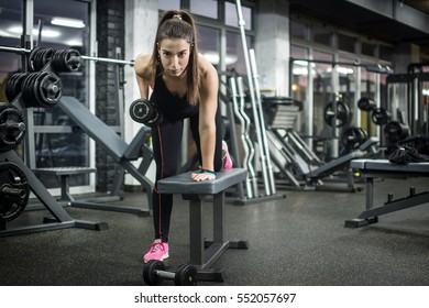 Young woman workout in gym.