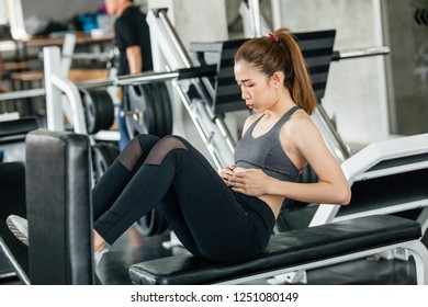 Young woman workout in gym healthy. girl doing abs exercises on floor in the gym. woman Asia