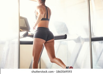 Young woman workout in gym healthy lifestyle doing cardio training on treadmill. Running on a treadmill.