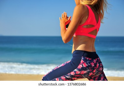 Young woman and workout on the beach