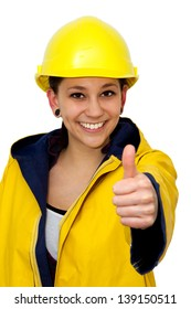 Young woman in workwear with thumb up, isolated on white background