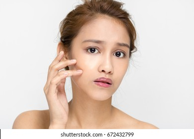 young woman worrying about her skin. beauty and skincare concept.