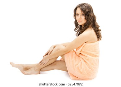 young woman wrapped in a towel