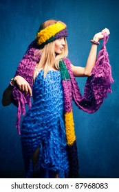 young woman wrapped in wool scarfs, studio shot