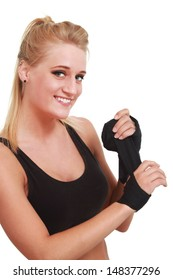 Young woman wrapping her hands for a fight