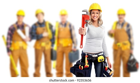 Young woman with a wrench and a group of industrial workers.