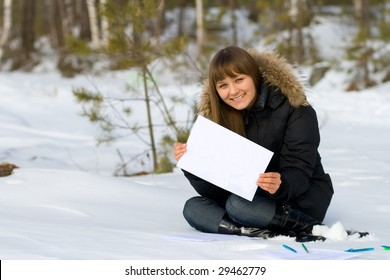 young woman write with pen in winter forest