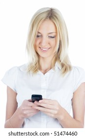 Young woman writing sms on mobile phone at isolated background