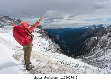 young woman wyth knapsack hiking in dolomiti alps mountain